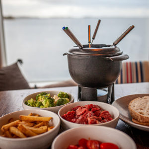 Fondue meal served in seaside café-restaurant Nokkalan Majakka in Espoo.