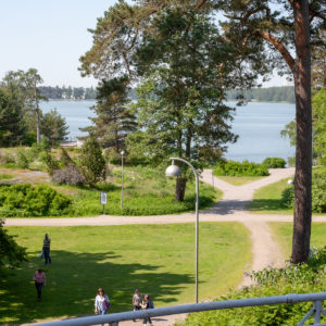 The view from café-restaurant Seurasaaren Kruunu's terrace is to the to green island of Seurasaari.