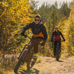 Biking with Fatbike in the autumn foliage in Levi, Lapland.